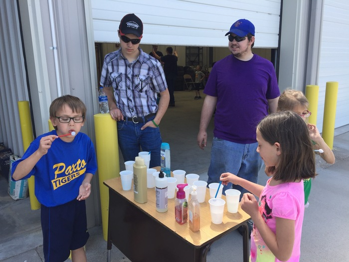 Tanner and Caleb helping students test various bubble making materials.