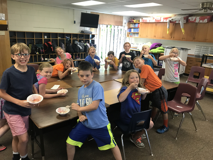 Third Grade spent all year passing weekly multiplication tests. each time they passed they earned a piece of their banana split. Today they all celebrate for passing every test.