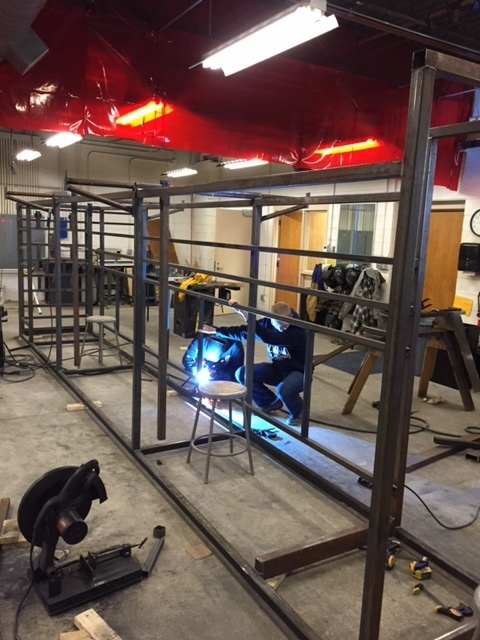 Shop students welding on the alley way