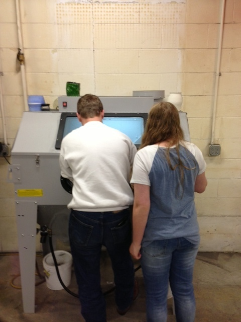 Students sandblasting for the first time.